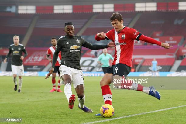 Aaron Wan-Bissaka of Manchester United battles for possession with Jannik Vestergaard of Southampton during the Premier League match between...