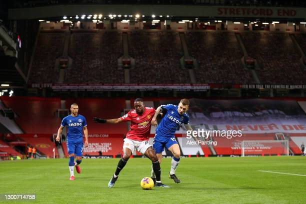 Aaron Wan-Bissaka of Manchester United battles for possession with Lucas Digne of Everton during the Premier League match between Manchester United...