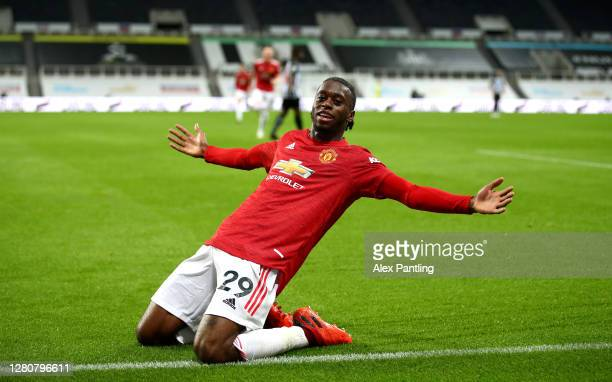 Aaron Wan-Bissaka of Manchester United celebrates after scoring his team's third goal during the Premier League match between Newcastle United and...