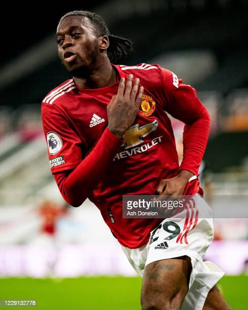 Aaron Wan-Bissaka of Manchester United celebrates scoring a goal to make the score 1-3 during the Premier League match between Newcastle United and...