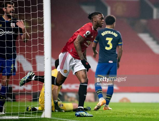 Aaron Wan-Bissaka of Manchester United celebrates scoring a goal to make the score 1-0 during the Premier League match between Manchester United and...