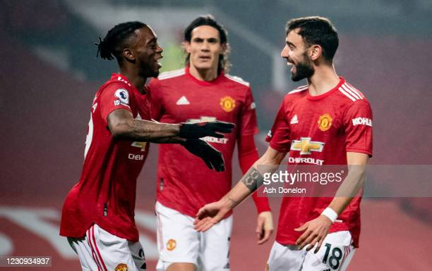Aaron Wan-Bissaka of Manchester United celebrates scoring a goal to make the score 1-0 with Bruno Fernandes during the Premier League match between...