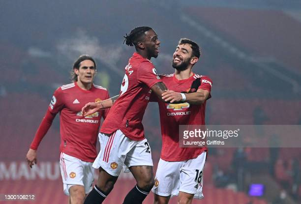 Aaron Wan-Bissaka of Manchester United celebrates scoring the first goal with Bruno Fernandes during the Premier League match between Manchester...