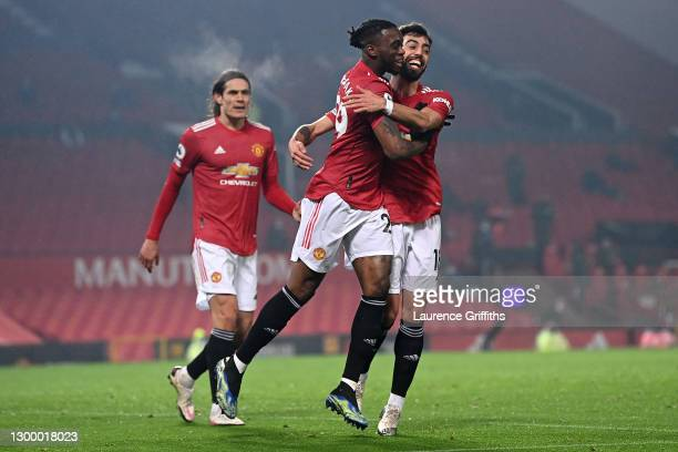Aaron Wan-Bissaka of Manchester United celebrates with team mate Bruno Fernandes of Manchester United after scoring their side's first goal during...