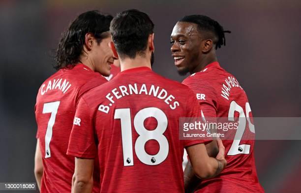 Aaron Wan-Bissaka of Manchester United celebrates with team mates Edinson Cavani and Bruno Fernandes of Manchester United after scoring their side's...