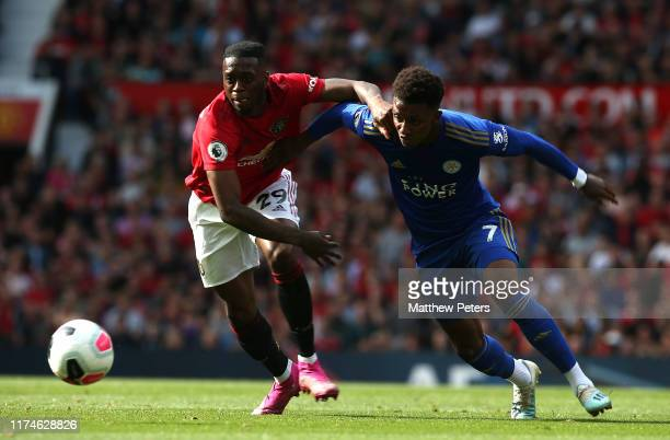 Aaron WanBissaka of Manchester United in action with Demarai Gray of Leicester City during the Premier League match between Manchester United and...