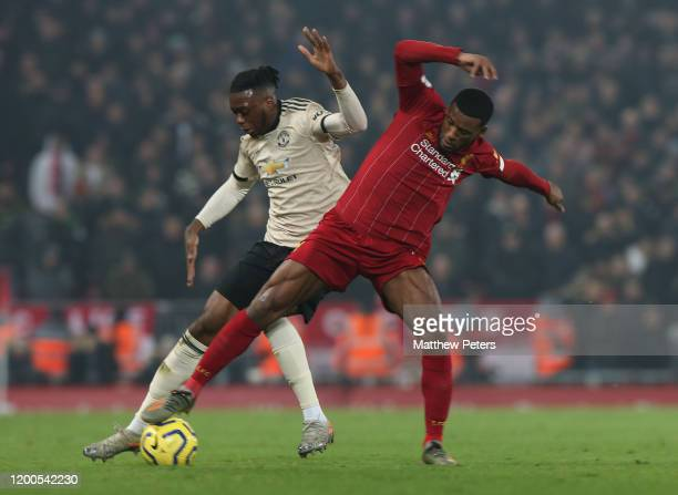 Aaron Wan-Bissaka of Manchester United in action with Georginio Wijnaldum of Liverpool during the Premier League match between Liverpool FC and...