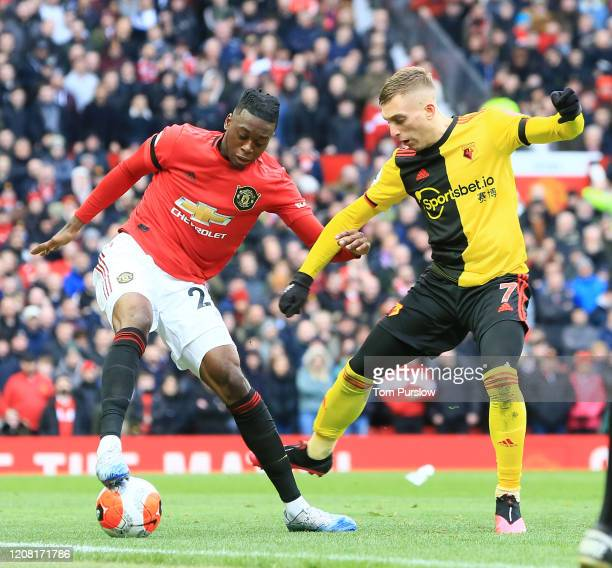 Aaron WanBissaka of Manchester United in action with Gerard Deulofeu of Watford during the Premier League match between Manchester United and Watford...