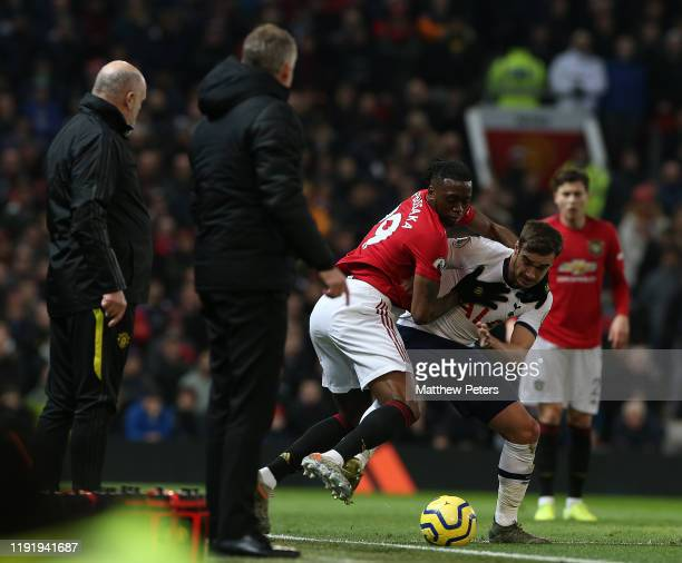 Aaron Wan-Bissaka of Manchester United in action with Harry Winks of Tottenham Hotspur during the Premier League match between Manchester United and...