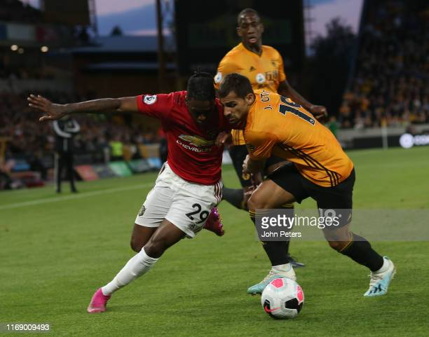 Aaron WanBissaka of Manchester United in action with Jonny Otto of Wolverhampton Wanderers during the Premier League match between Wolverhampton...