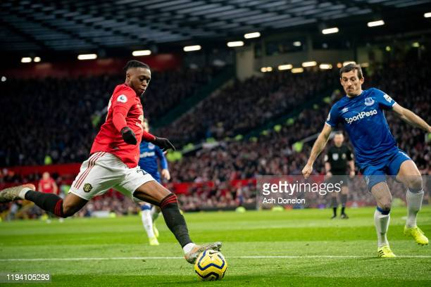 Aaron WanBissaka of Manchester United in action with Leighton Baines of Everton during the Premier League match between Manchester United and Everton...