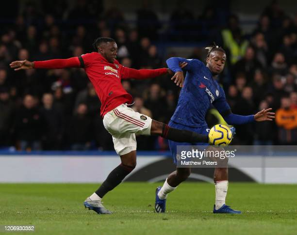 Aaron WanBissaka of Manchester United in action with Michy Batshuayi of Chelsea during the Premier League match between Chelsea FC and Manchester...