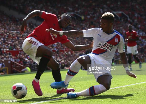 Aaron Wan-Bissaka of Manchester United in action with Patrick van Aanholt of Crystal Palace during the Premier League match between Manchester United...