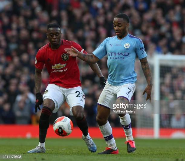 Aaron WanBissaka of Manchester United in action with Raheem Sterling of Manchester City during the Premier League match between Manchester United and...