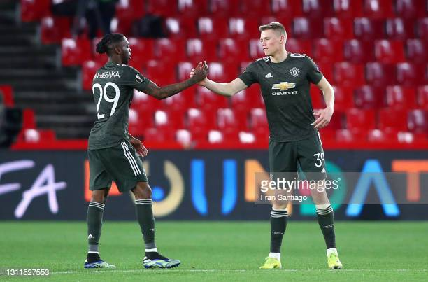Aaron Wan-Bissaka of Manchester United interacts with Scott McTominay of Manchester United during the UEFA Europa League Quarter Final First Leg...