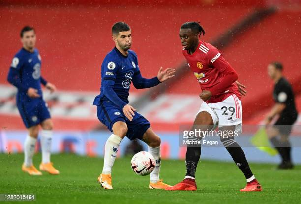 Aaron WanBissaka of Manchester United is challenged by Christian Pulisic of Chelsea during the Premier League match between Manchester United and...
