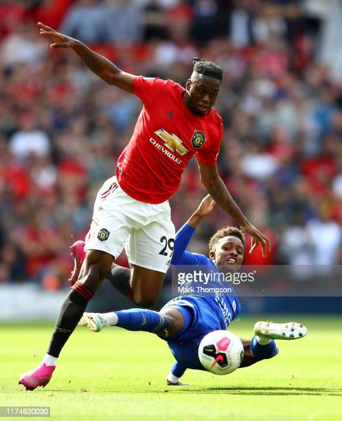 Aaron WanBissaka of Manchester United is challenged by Demarai Gray of Leicester City during the Premier League match between Manchester United and...