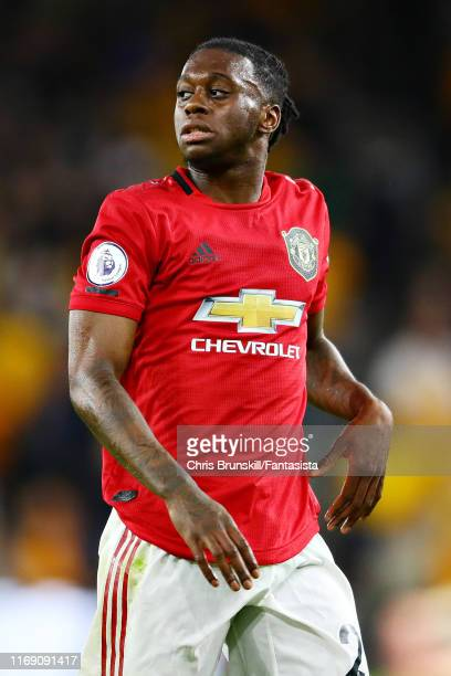 Aaron WanBissaka of Manchester United looks on during the Premier League match between Wolverhampton Wanderers and Manchester United at Molineux on...