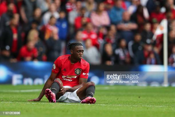 Aaron WanBissaka of Manchester United on the floor after a challenge during the Premier League match between Manchester United and Chelsea FC at Old...