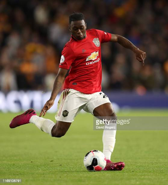 Aaron WanBissaka of Manchester United passes the ball during the Premier League match between Wolverhampton Wanderers and Manchester United at...