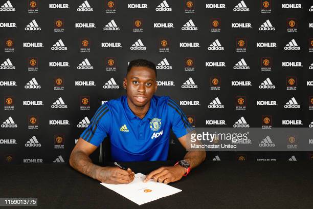 Aaron Wan-Bissaka of Manchester United poses after signing for the club at Aon Training Complex on June 29, 2019 in Manchester, England.
