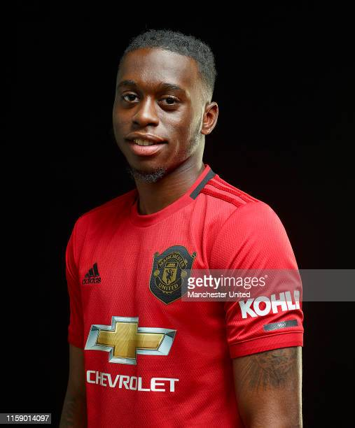 Aaron WanBissaka of Manchester United poses after signing for the club at Aon Training Complex on June 29 2019 in Manchester England