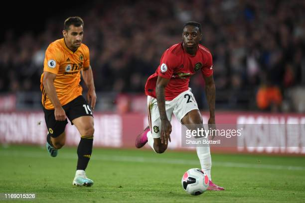 Aaron WanBissaka of Manchester United runs with the ball as he is challenged by Jonny Otto of Wolverhampton Wanderers during the Premier League match...