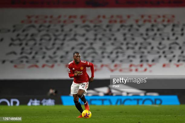 Aaron Wan-Bissaka of Manchester United runs with the ball during the Premier League match between Fulham and Manchester United at Craven Cottage on...