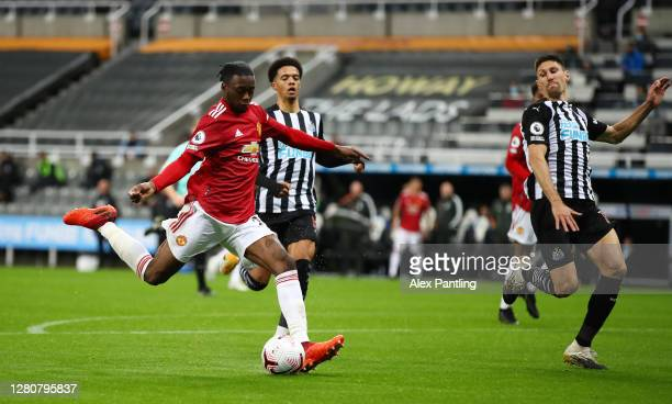 Aaron Wan-Bissaka of Manchester United scores his team's third goal during the Premier League match between Newcastle United and Manchester United at...