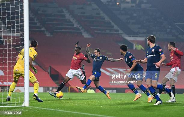 Aaron Wan-Bissaka of Manchester United scores their side's first goal during the Premier League match between Manchester United and Southampton at...