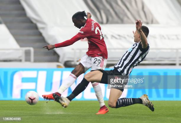 Aaron Wan-Bissaka of Manchester United scores their third goal during the Premier League match between Newcastle United and Manchester United at St....
