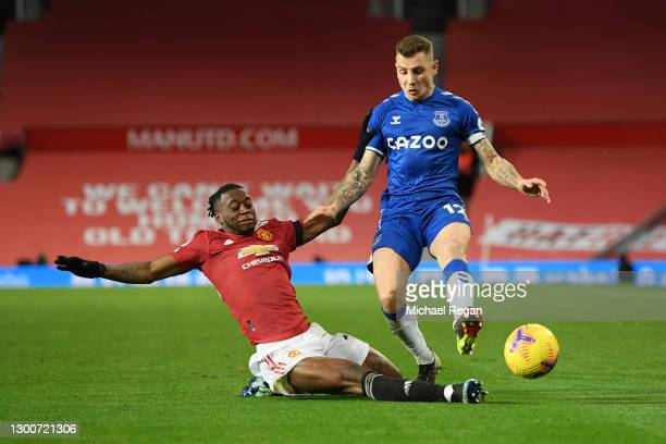 Aaron Wan-Bissaka of Manchester United tackles Lucas Digne of Everton during the Premier League match between Manchester United and Everton at Old...