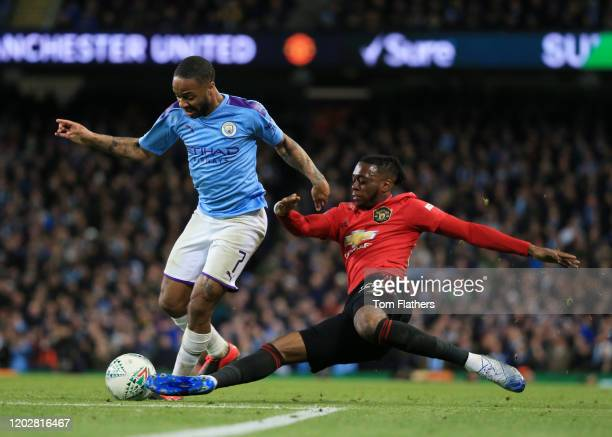 Aaron Wan-Bissaka of Manchester United tackles Raheem Sterling of Manchester City during the Carabao Cup Semi Final match between Manchester City and...
