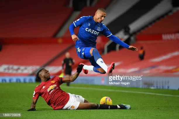 Aaron Wan-Bissaka of Manchester United tackles Richarlison of Everton during the Premier League match between Manchester United and Everton at Old...