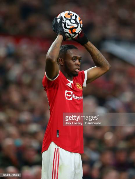 Aaron Wan-Bissaka of Manchester United takes a throw in during the Premier League match between Manchester United and Liverpool at Old Trafford on...