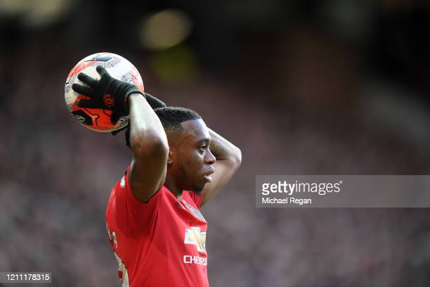Aaron Wan-Bissaka of Manchester United throws the ball in during the Premier League match between Manchester United and Manchester City at Old...
