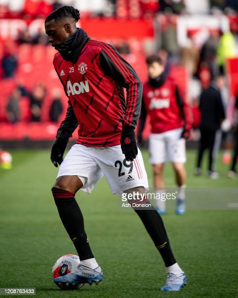 Aaron WanBissaka of Manchester United warms up ahead of the Premier League match between Manchester United and Watford FC at Old Trafford on February...