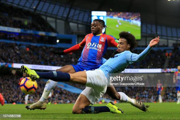 Aaron Wan-Bissaka of Palace battles with Leroy Sane of Man City during the Premier League match between Manchester City and Crystal Palace at the...