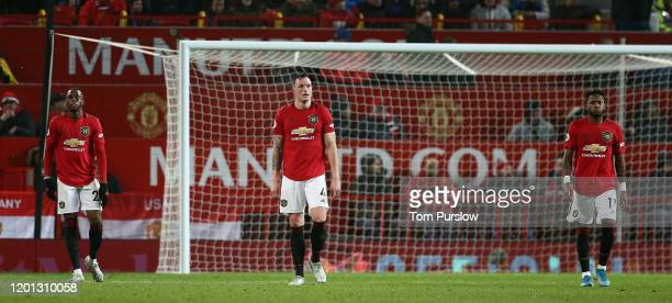 Aaron Wan-Bissaka, Phil Jones and Fred of Manchester United react to conceding a goal to Chris Wood of Burnley during the Premier League match...