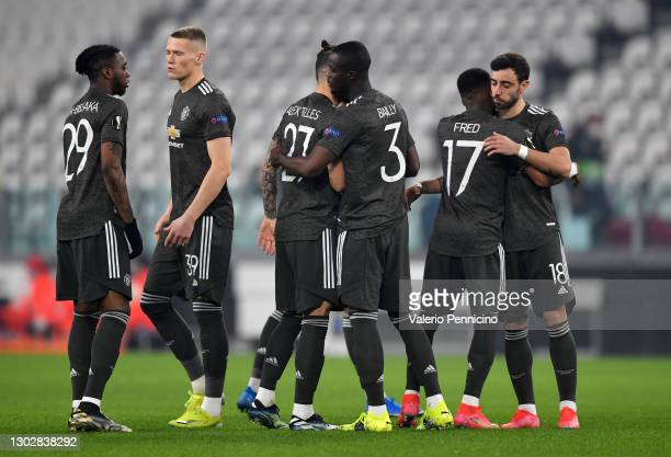 Aaron Wan-Bissaka, Scott McTominay, Alex Telles, Eric Bailly, Fred and Bruno Fernandes of Manchester United interact ahead of the UEFA Europa League...