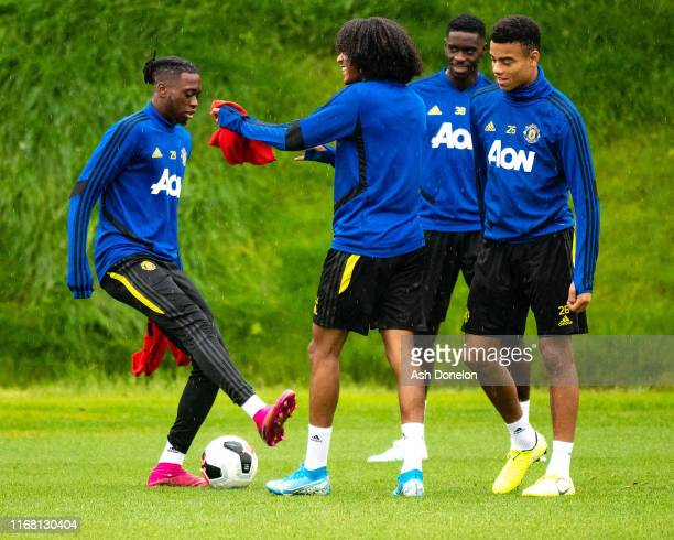 Aaron WanBissaka Tahith Chong Axel Tuanzebe Mason Greenwood of Manchester United in action during a first team training session at Aon Training...
