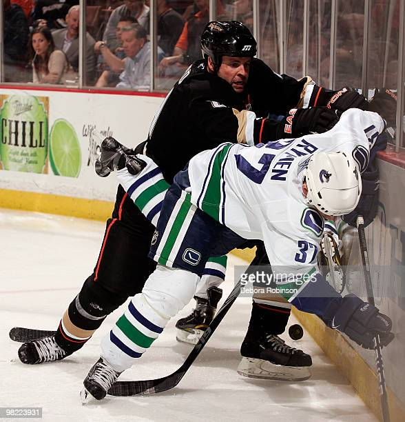 Aaron Ward of the Anaheim Ducks checks Rick Rypien of the Vancouver Canucks into the boards during the game on April 2 2010 at Honda Center in...
