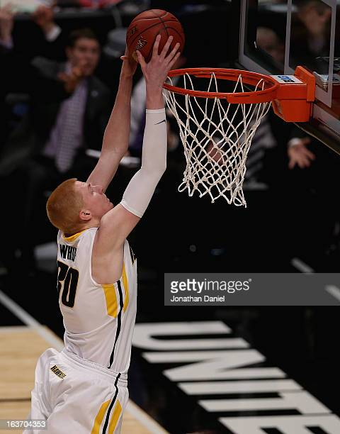 Aaron White of the Iowa Hawkeyes dunks against the Northwestern Wildcats during a first round game of the Big Ten Basketball Tournament at the United...