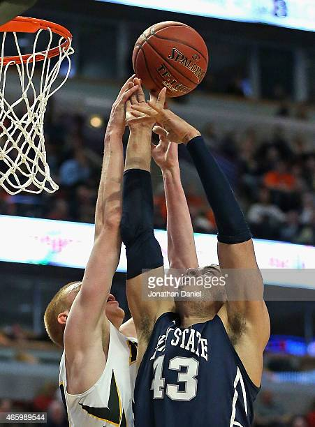 Aaron White of the Iowa Hawkeyes fouls Ross Travis of the Penn State Nittany Lions during the second round of the 2015 Big Ten Men's Basketball...