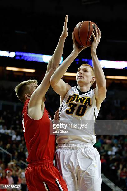 Aaron White of the Iowa Hawkeyes shoots the ball against Peyton Aldridge of the Davidson Wildcats in the second half of the game during the second...