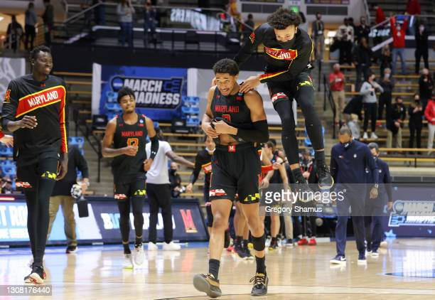 Aaron Wiggins of the Maryland Terrapins celebrates with teammates following the victory against the Connecticut Huskies in the first round game of...