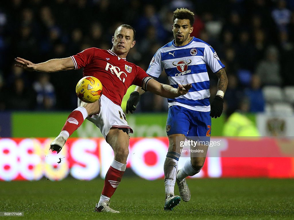 Aaron Wilbraham of Bristol City clears under pressure from Danny Williams of Reading during the Sky Bet Championship match between Reading and Bristol City on January 2, 2016 in Reading, United Kingdom.