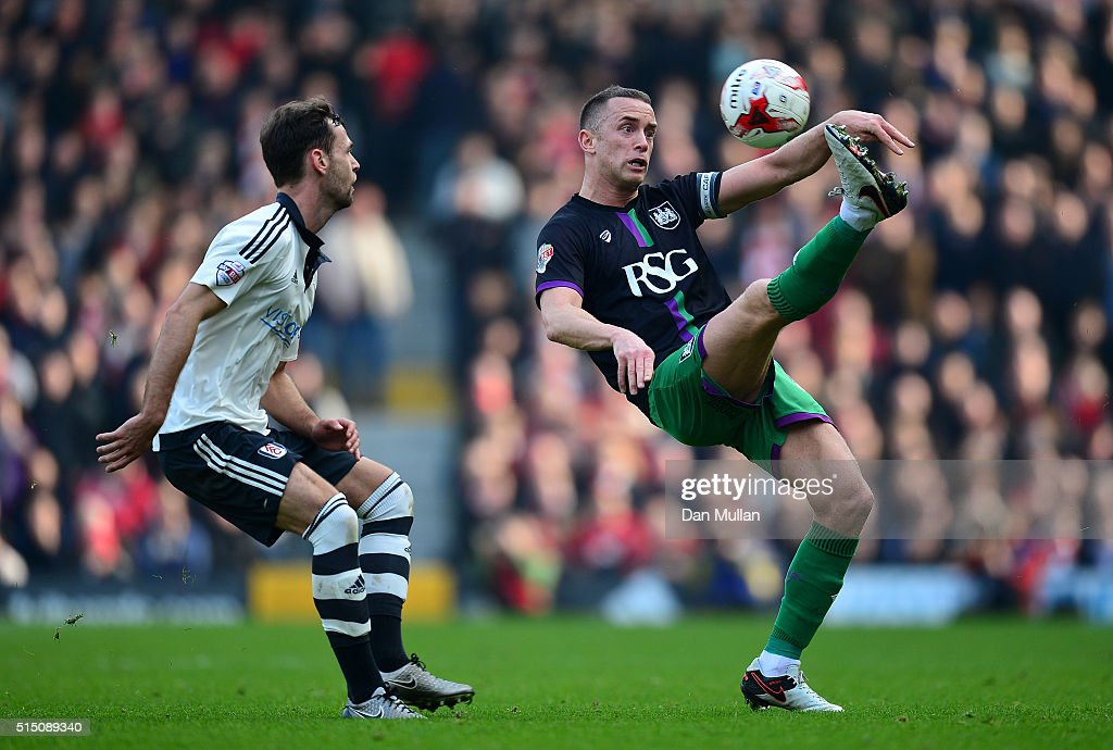 Aaron Wilbraham of Bristol City controls the ball under pressure from Michael Madl of Fulham during the Sky Bet Championship match between Fulham and Bristol City at Craven Cottage on March 12, 2016 in London, United Kingdom.