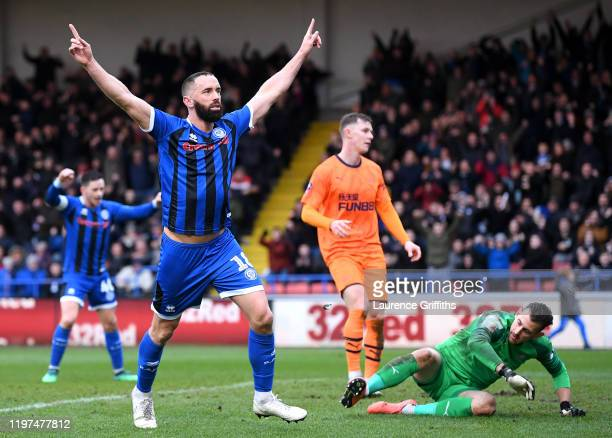 Aaron Wilbraham of Rochdale celebrates after scoring his team's first goal during the FA Cup Third Round match between Rochdale AFC and Newcastle...