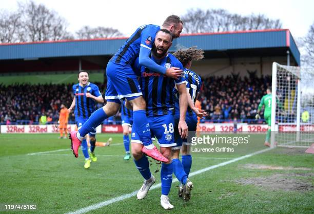 Aaron Wilbraham of Rochdale celebrates with teammates after scoring his team's first goal during the FA Cup Third Round match between Rochdale AFC...